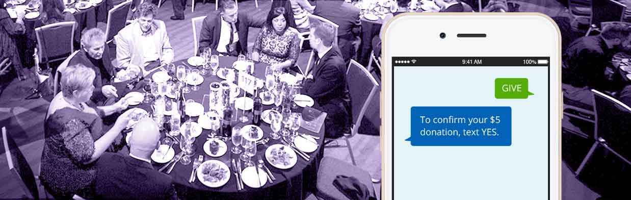 donations sent via smartphone text at a fundraising gala