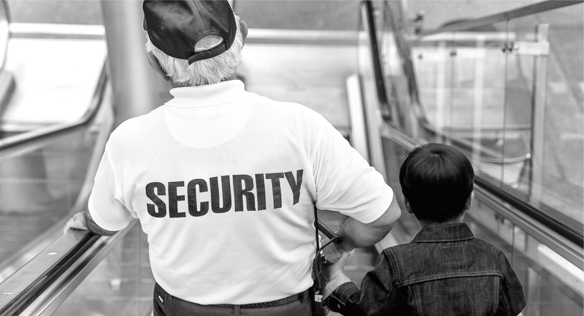 Security officer with lost child.